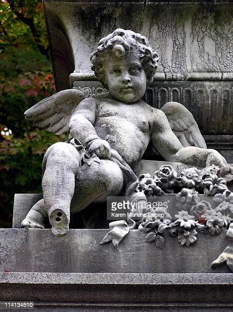 cherub on grande grave monument - cherub stock photos and pictures