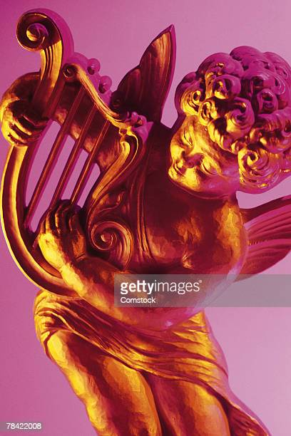 cherub with harp - cherub stock photos and pictures