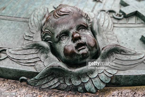 Cherub's face on a grave of Augustin Ehrensvärd at Suomenlinna, Finland