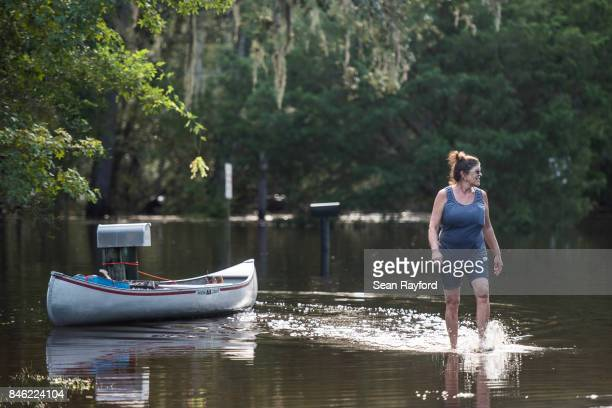 Cheryl Akridge looks out over flood waters caused by Hurricane Irma September 12 2017 in Middleburg Florida United States The storm brought flooding...