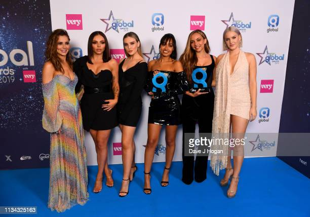 Cheryl and Anne Marie present Jesy Nelson Perrie Edwards LeighAnne Pinnock Jade Thirlwall of Little Mix with the Best Group Award at the The Global...