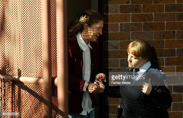 Cheryl Ann Scott is escorted out of Nowra court 10 July 2003 ILM Picture by SYLVIA LIBER