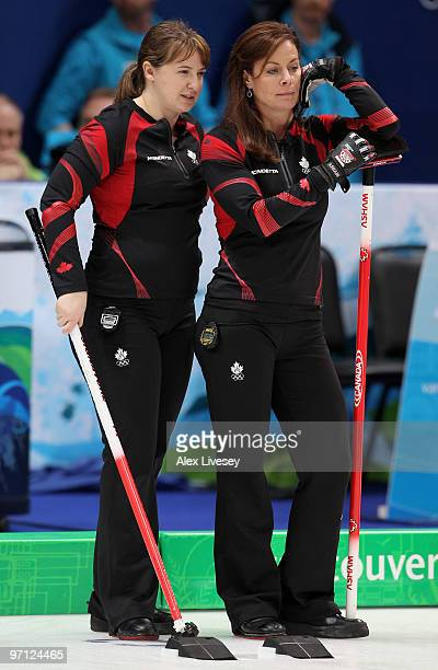 Cheryl Bernard and Susan O'Connor of Canada look on during the women's gold medal curling game between Canada and Sweden on day 15 of the Vancouver...