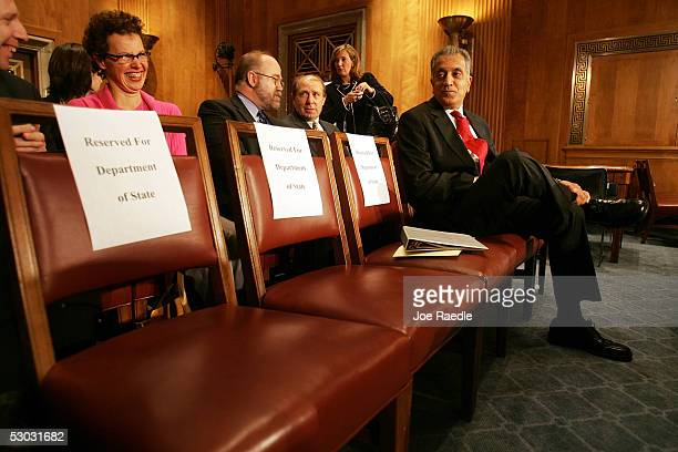 Cheryl Bernard sits near her husband Zalmay Khalilzad before the start of testimony in front of the Foreign Relations Committee as they consider his...