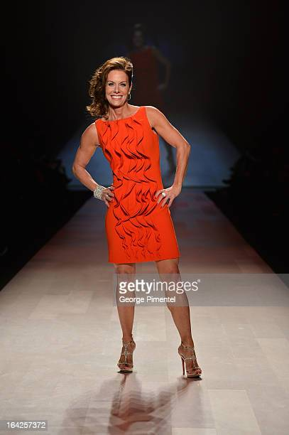Cheryl Bernard walks the runway weraing Ross Mayer design for the Heart and Truth fashion show during World MasterCard Fashion Week Fall 2013 at...