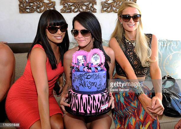 Cheryl Burke Allison Melnick and Paris Hilton attend Melnick's birthday celebration at Daylight Beach Club at the Mandalay Bay Resort Casino on June...