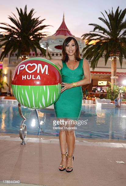 Cheryl Burke celebrates POM Wonderful's launch of three new 100% Juice Blends by leading 125 people in setting the Guinness World Record for the...