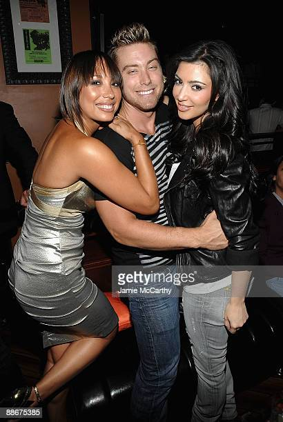 Cheryl Burke Lance Bass and Kim Kardashian attend the AXE Instinct launch party at the Hard Rock Live on June 24 2009 in New York City