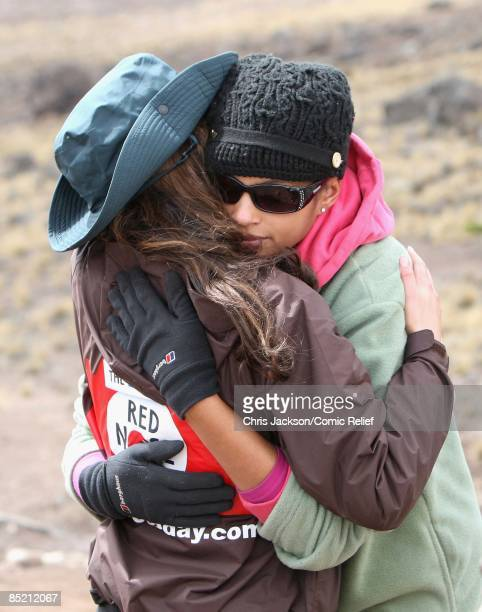 Cheryl Cole and Alesha Dixon embrace as they arrive in camp on the third day of The BT Red Nose Climb of Kilimanjaro on March 4 2009 in Arusha...