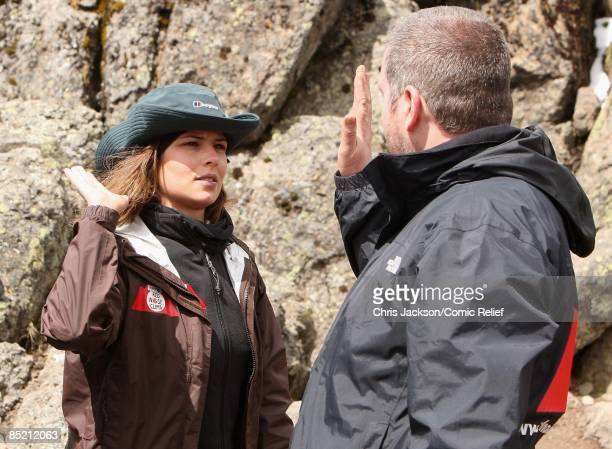 Cheryl Cole and Chris Moyles high five after a gruelling days trekking on the third day of The BT Red Nose Climb of Kilimanjaro on March 4 2009 in...