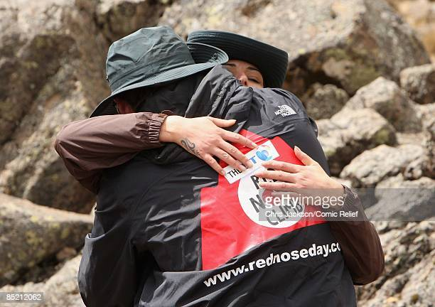 Cheryl Cole and embrace after a gruelling days trekking on the third day of The BT Red Nose Climb of Kilimanjaro on March 4 2009 in Arusha Tanzania...