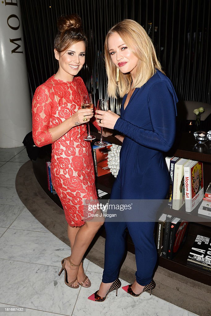 Cheryl Cole and Kimberley Walsh attend the launch party for Kimerley Walsh 'A Whole Lot Of History' at Hotel ME on September 23, 2013 in London, England.