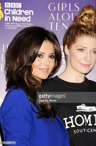 Cheryl Cole and Nicola Roberts of Girls Aloud pose at a press conference to announce 'Girls Aloud Ten The Hits Tour 2013' at The Corinthia Hotel on...