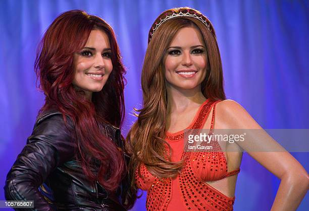Cheryl Cole attends a photocall as her waxwork figure is unveiled at Madame Tussauds on October 20 2010 in London England