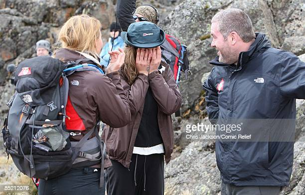 Cheryl Cole Chris Moyles and Kimberley Walsh comfort each other during a gruelling days trekking on the third day of The BT Red Nose Climb of...