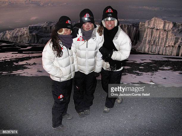 Cheryl Cole Fearne Cotton and Denise Van Outen pose in front of the Kilimanjaro Galcier as they reach the top of Mount Kilimanjaro on the seventh day...