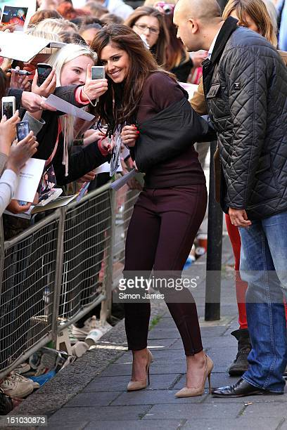Cheryl Cole is seen with her arm in a sling following a car accident as she meets some fans at BBC radio one on August 31, 2012 in London, England.