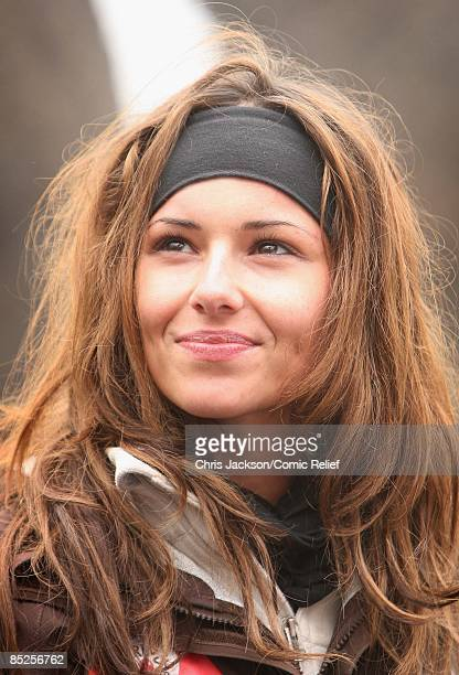Cheryl Cole smiles as she takes a break from trekking on the fifth day of The BT Red Nose Climb of Kilimanjaro on March 5 2009 near Arusha Tanzania...