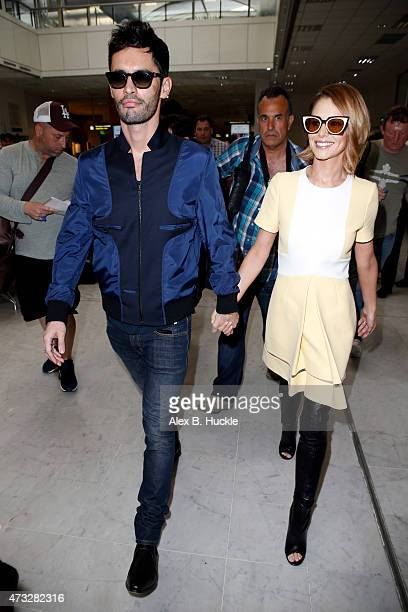 Cheryl FernandezVersini and husband JeanBernard FernandezVersini arrive at Nice Airport for The 68th Annual Cannes Film Festival on May 14 2015 in...