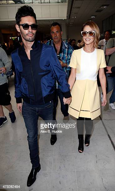 Cheryl FernandezVersini and husband JeanBernard FernandezVersini arrive at Nice Airport for The 68th Annual Cannes Film Festival on May 14 2015 in...