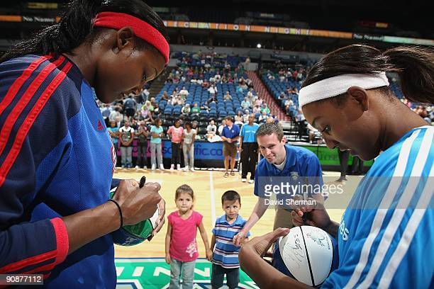 Cheryl Ford of the Detroit Shock and Candice Wiggins of the Minnesota Lynx sign autographs for fans prior to the game on September 9 2009 at the...