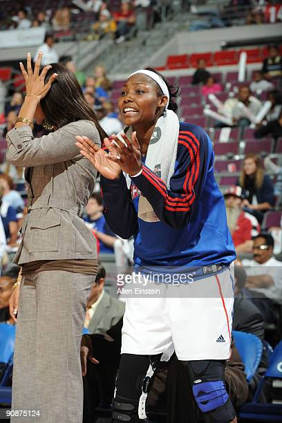 Cheryl Ford of the Detroit Shock cheers on her team from the bench during a game against the Atlanta Dream in Game One of the WNBA Eastern Conference...