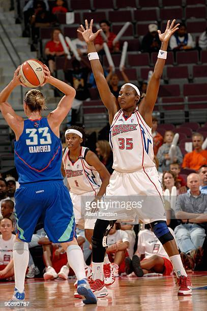 Cheryl Ford of the Detroit Shock defends Catherine Kraayeveld of the New York Liberty during the WNBA game on September 10 2009 at The Palace of...