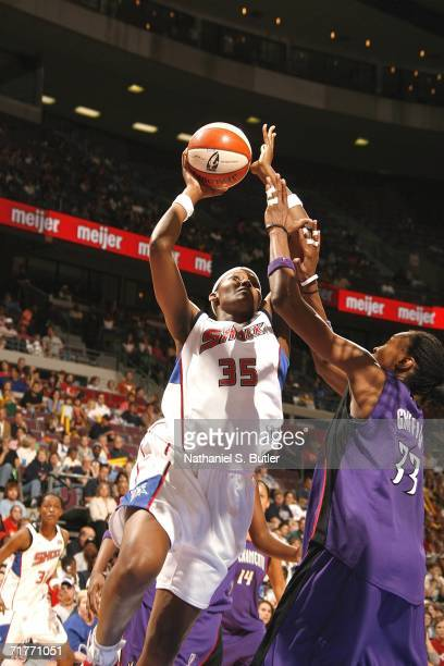 Cheryl Ford of the Detroit Shock drives to the basket against Yolanda Griffith of the Sacramento Monarchs during Game Two of the 2006 WNBA Finals...
