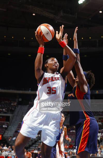 Cheryl Ford of the Detroit Shock goes up for a shot during the game against the Connecticut Sun at The Palace of Auburn Hills on June 27 2004 in...