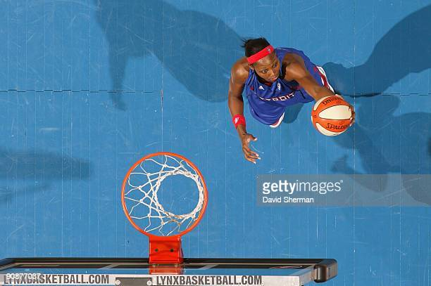 Cheryl Ford of the Detroit Shock grabs a rebound against the Minnesota Lynx during the game on September 9 2009 at the Target Center in Minneapolis...