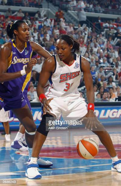 Cheryl Ford of the Detroit Shock is defended by Lisa Leslie of the Los Angeles Sparks during game two of the 2003 WNBA Finals at the Palace of Auburn...