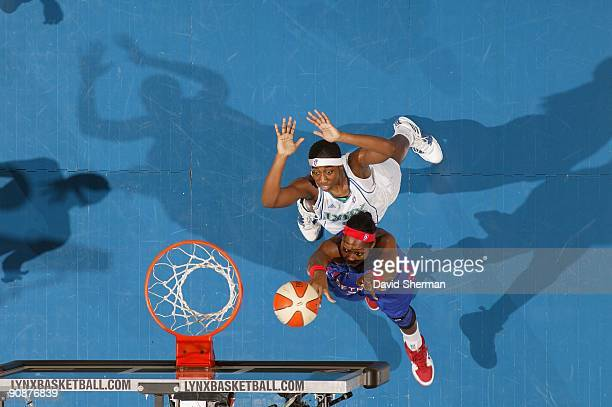 Cheryl Ford of the Detroit Shock lays up a shot against Quanitra Hollingsworth of the Minnesota Lynx during the game on September 9 2009 at the...
