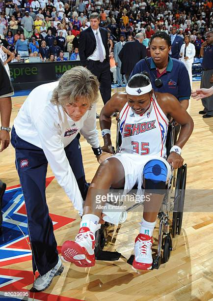 Cheryl Ford of the Detroit Shock leaves the court in a wheelchair during a game against the Los Angeles Sparks on July 22 2008 at the Palace of...