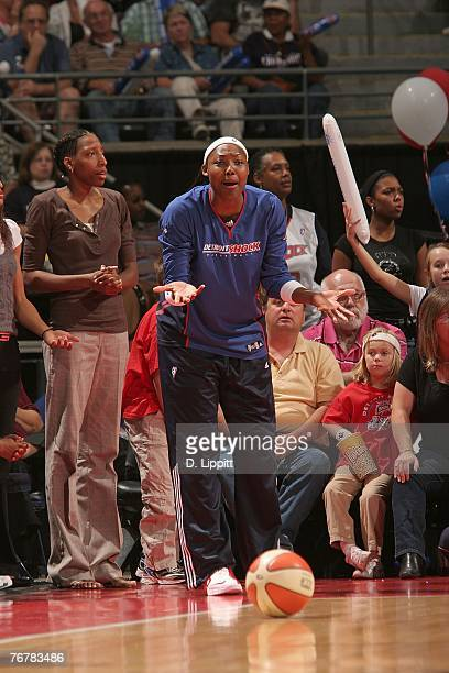 Cheryl Ford of the Detroit Shock looks on from the bench during Game Five of the WNBA Finals against the Phoenix Mercury at The Palace of Auburn...