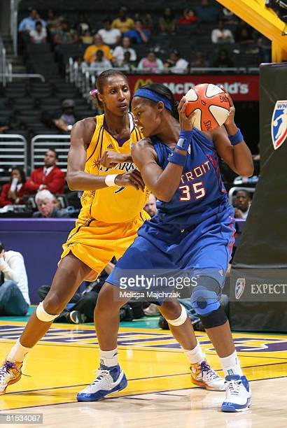 Cheryl Ford of the Detroit Shock looks to make a move against Lisa Leslie of the Los Angeles Sparks at Staples Center on June 11 2008 in Los Angeles...