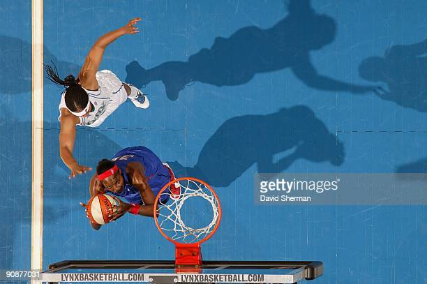 Cheryl Ford of the Detroit Shock looks to score against Tasha Humphrey of the Minnesota Lynx during the game on September 9 2009 at the Target Center...