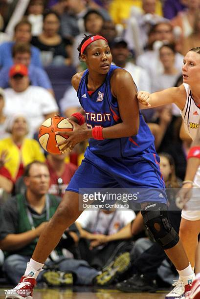 Cheryl Ford of the Detroit Shock moves the ball against the Phoenix Mercury in Game 3 of the WNBA Finals on September 11 2007 at US Airways Center in...