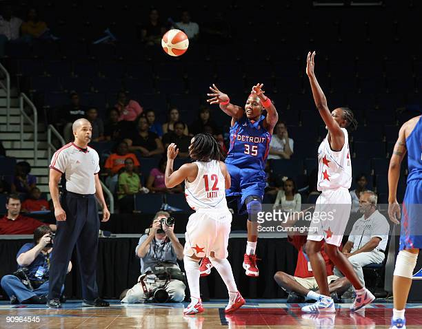 Cheryl Ford of the Detroit Shock passes off during Game Two of the WNBA Eastern Conference Semifinals against the Atlanta Dream at Gwinnett Arena on...