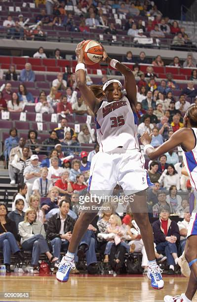 Cheryl Ford of the Detroit Shock pulls down a rebound against the Los Angeles Sparks May 29 2004 at the Palace of Auburn Hills in Auburn Hills...