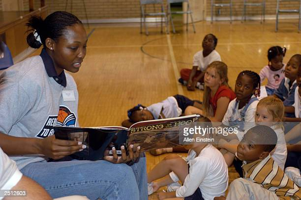 Cheryl Ford of the Detroit Shock reads to school children from Ralph Waldo Emerson Elementary as the Shock host a Read to Achieve reading rally on...
