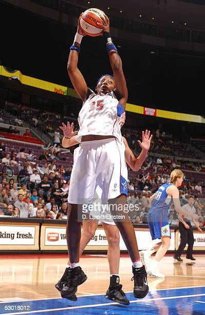 Cheryl Ford of the Detroit Shock rebounds against the New York Liberty during their game at the Palace of Auburn Hills June 3 2005 in Auburn Hills...