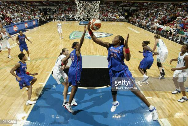 Cheryl Ford of the Detroit Shock rebounds during the game against the Minnesota Lynx on August 23 2003 at the Target Center in Minneapolis Minnesota...