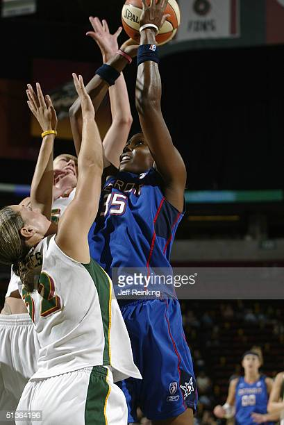 Cheryl Ford of the Detroit Shock shoots over Adia Barnes of the Seattle Storm during the game at Key Arena on September 8 2004 in Seattle Washington...