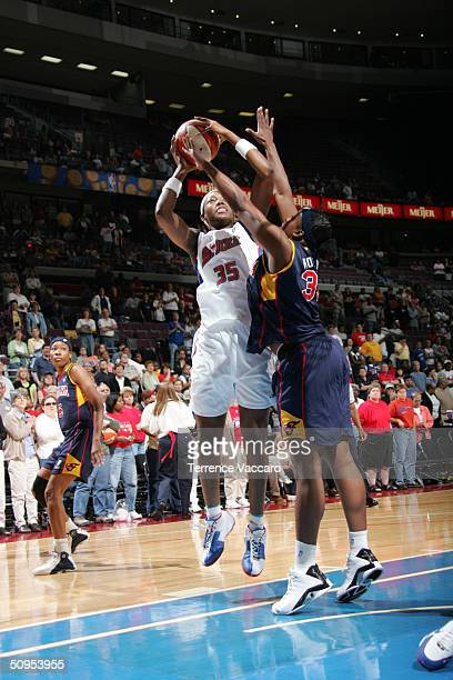 Cheryl Ford of the Detroit Shock shoots over Ebony Hoffman of the Indiana Fever at the Palace of Auburn Hills on June 12 2004 in Auburn Hills...