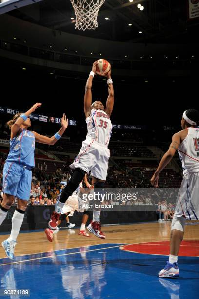 Cheryl Ford of the Detroit Shock stretches out for a rebound against Erika de Souza of the Atlanta Dream in Game One of the WNBA Eastern Conference...