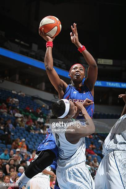 Cheryl Ford of the Detroit Shock takes the ball to the basket against Rashanda McCants of the Minnesota Lynx during the game on September 9 2009 at...