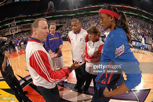 Cheryl Ford of the Detroit Shock talks with referees as well as Penny Taylor of the Phoenix Mercury before Game Three of the WNBA Finals the U.S....
