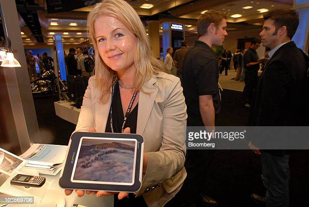 Cheryl Goodman a marketing director for Qualcomm Inc displays a 57 inch Qualcomm Mirasol eink reflective display at the Uplinq 2010 Conference in San...