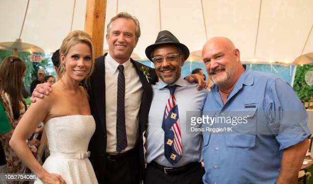 Cheryl Hines and Robert F Kennedy Jr pose with Giancarlo Esposito and Captain Keith Colburn at the Cheryl Hines and Robert F Kennedy Jr Wedding at a...