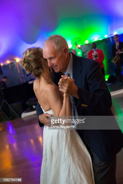 Cheryl Hines dances with James Hines at the Cheryl Hines and Robert F Kennedy Jr Wedding at a private home on Saturday August 2 in Hyannis Port...